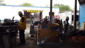 Sorting recyclable materials at All American Recycling in Austin, TX