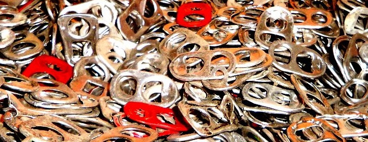Pull tabs from aluminum cans at All American Recycling in Austin